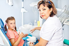 Dentist giving oral hygiene instructions Stock Images