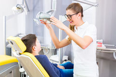 Dentist giving patient advice Royalty Free Stock Image