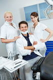 Dentist with group of dental assistants. In his dental practice royalty free stock photos