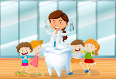 Dentist and happy children Stock Photography