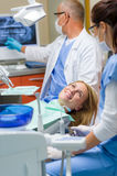 At the dentist happy woman after treatment Stock Image
