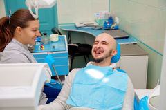 Dentist having fun with patient during treatment Royalty Free Stock Photos
