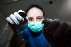 Dentist from hell. Crazy dentist with stains of blood on his face Stock Photos