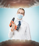 Dentist from hell Royalty Free Stock Images
