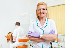 Dentist and her assistant examining teeth Royalty Free Stock Image