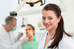 Dentist in her surgery Stock Image