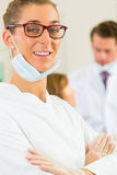 Dentist in her surgery Royalty Free Stock Images