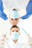 Dentist and his assistant holding instruments Royalty Free Stock Photography