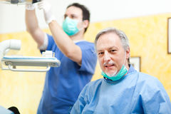 Dentist and his assistant in studio Stock Photo