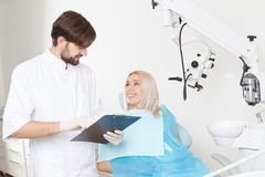 Dentist and his female patient in clinic Stock Image