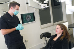 Dentist and his patient Royalty Free Stock Photography