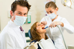 Dentist in his surgery Stock Images