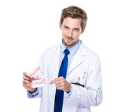 Dentist hold with denture and toothbrush Stock Photos