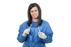 Dentist holding dental instuments Royalty Free Stock Photography