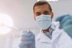Dentist holding dental tools stock image