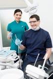 Dentist Holding Dental Tools Royalty Free Stock Photos