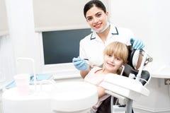 Dentist Holding Dental Tools Stock Photography