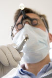 Dentist holding drill Stock Photos