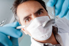 Dentist holding instruments Royalty Free Stock Photos