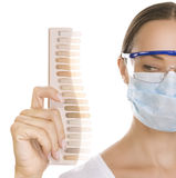 Dentist  holding Palette for tooth color, color matching and tee Stock Image