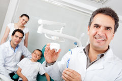 Dentist holding a toothbrush Stock Photography