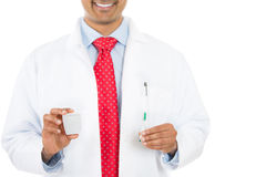 Dentist holding a toothbrush and dental floss Stock Photo