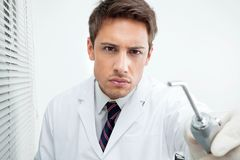 Dentist Holding Water Spraying Tool Royalty Free Stock Photo