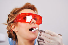 Dentist inserts swab Royalty Free Stock Image