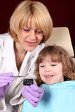 Dentist and little girl Stock Images
