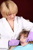 Dentist and little girl patient Royalty Free Stock Photo