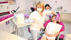 Dentist and little girl patient Royalty Free Stock Photos