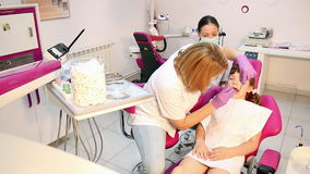 Dentist and little girl patient Royalty Free Stock Images
