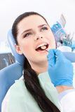 Dentist is looking for the defects in oral cavity Stock Image