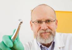 Dentist looking down at the camera Stock Photo