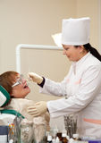 Dentist  looking  her  patient Royalty Free Stock Photo