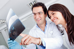 Dentist looking at an x-ray Stock Photography