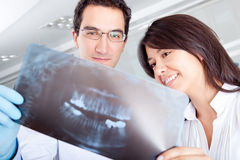 Dentist looking at an x-ray Stock Photos