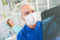 Dentist looking at x-ray Stock Photography