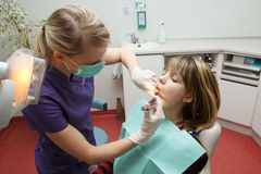 Dentist make anesthesia. A dentist make anesthesia with a syringe Stock Photography