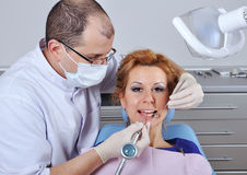 Dentist makes cleaning Royalty Free Stock Photo