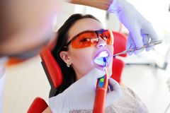 Beautiful girl in the dentist`s chair stock images