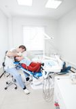 Dentist makes dental treatment to the patient. Royalty Free Stock Photography