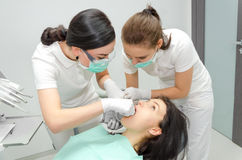 Dentist makes a X-ray of the patient. In the clinic Royalty Free Stock Image