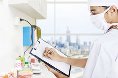 Dentist makes a report Stock Photography