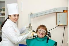 Dentist makes teeth X-ray Stock Photos