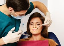 Dentist making anaesthetic injection Royalty Free Stock Photography