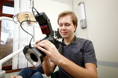 Dentist making photos of patients smile Royalty Free Stock Photography