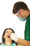Dentist male working with patient woman Royalty Free Stock Image