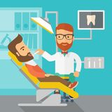 Dentist man examines a patient teeth in the clinic Royalty Free Stock Photo