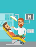 Dentist man examines a patient teeth in the clinic Royalty Free Stock Image